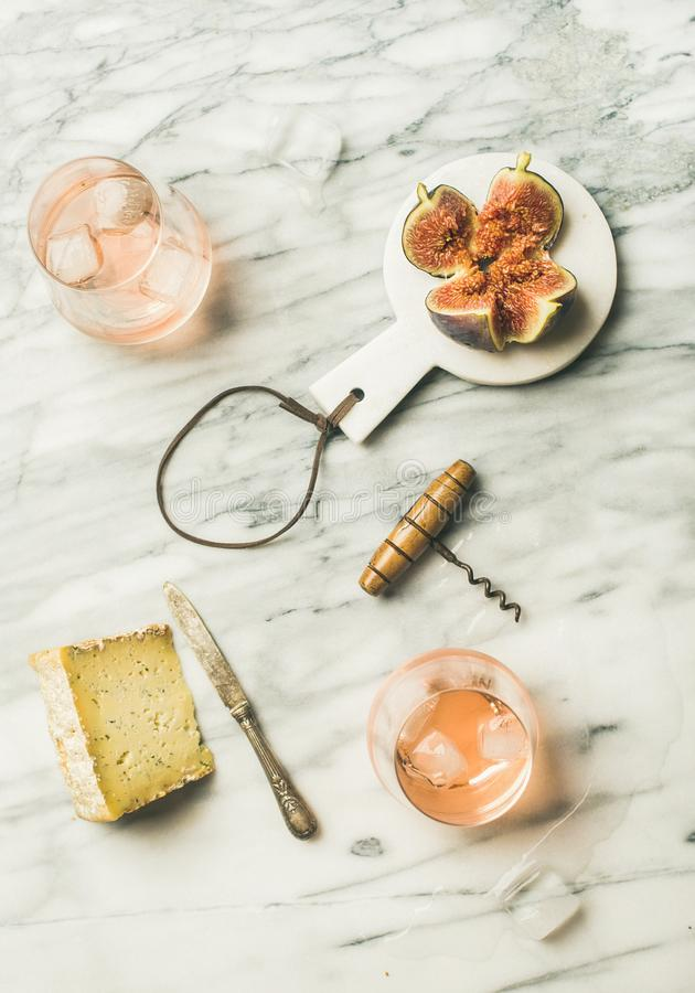 Glass of rose wine, fresh figs and cheese, top view stock images