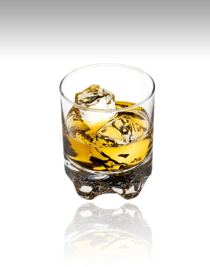 Glass of scotch with clipping path. Glass of scotch,bourbon or whiskey on white with clipping path stock photos