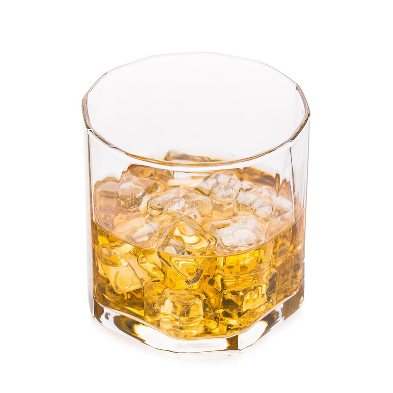 Glass of scotch whiskey and ice on a white background. stock images