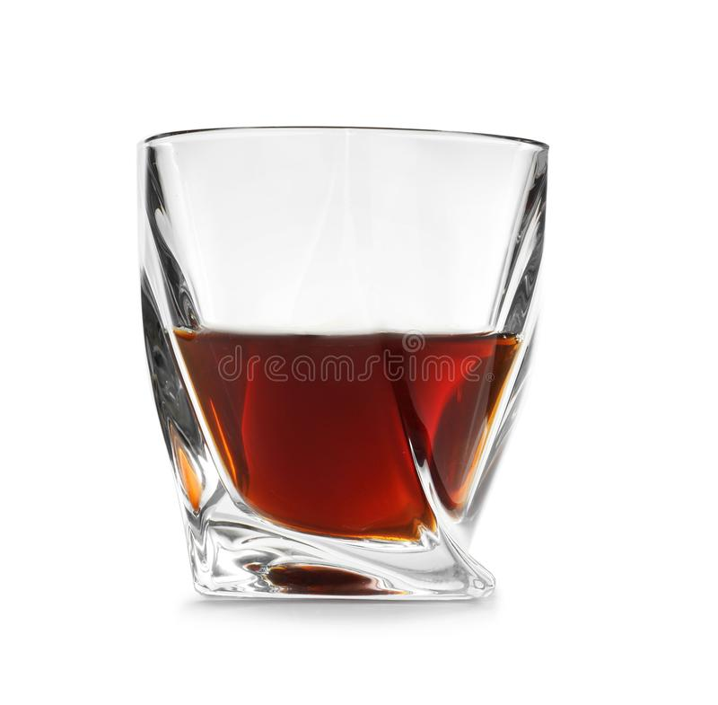 Glass of scotch whiskey on white background royalty free stock photo