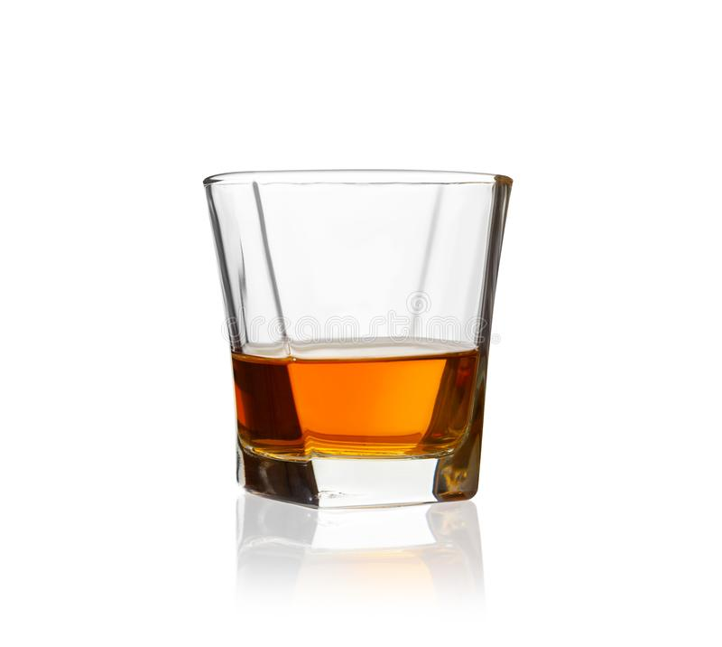 Glass of scotch whiskey isolated on a white background royalty free stock photo