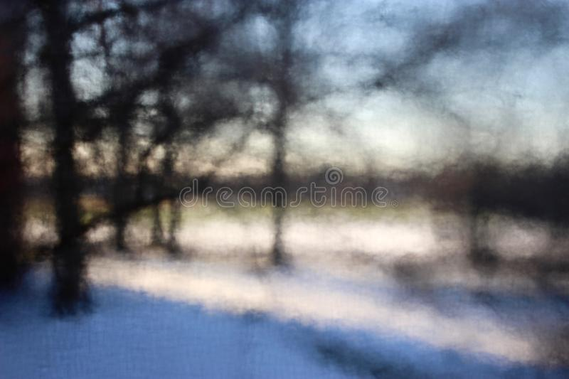 Winter tree blur across the park. Through glass and through screen, beyond this closed window winter, a soft evening begins stock image