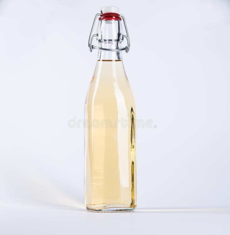 Glass bottle with yellow liquid royalty free stock photography