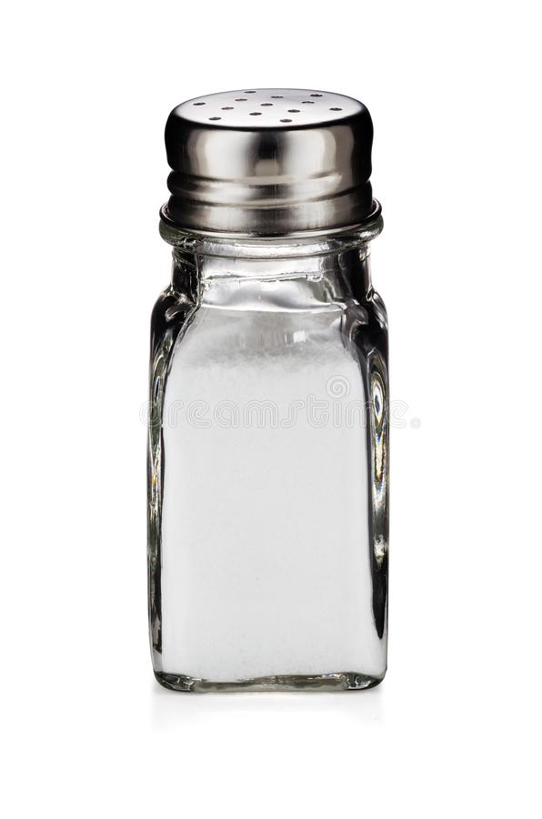 A glass shaker of table salt isolated on white background. With clipping path royalty free stock images