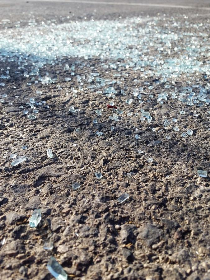 Glass shards Scattered On The Road - Close Up royalty free stock photos