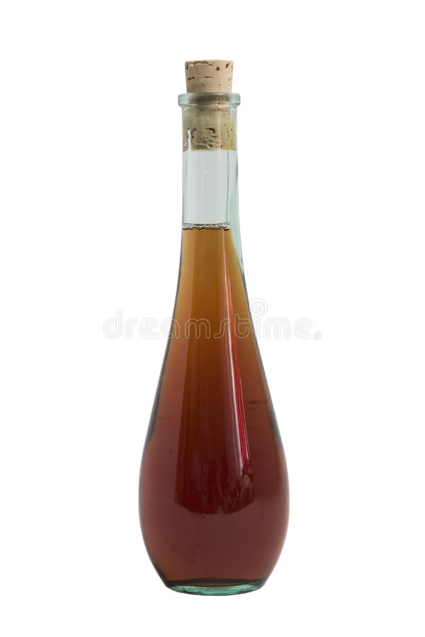 Glass single elegant bottle of alcohol drink like wisky, cognac, rom or liquor. Glass clean single shiny beautiful elegant round closed bottle of an alcohol royalty free stock photo