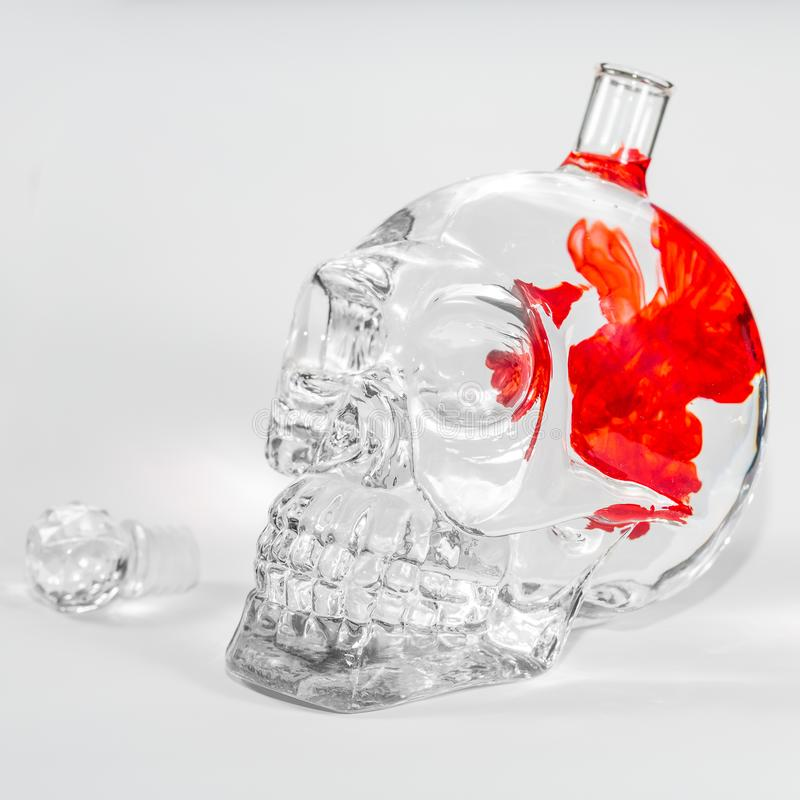 Glass skull with ink drops royalty free stock photography
