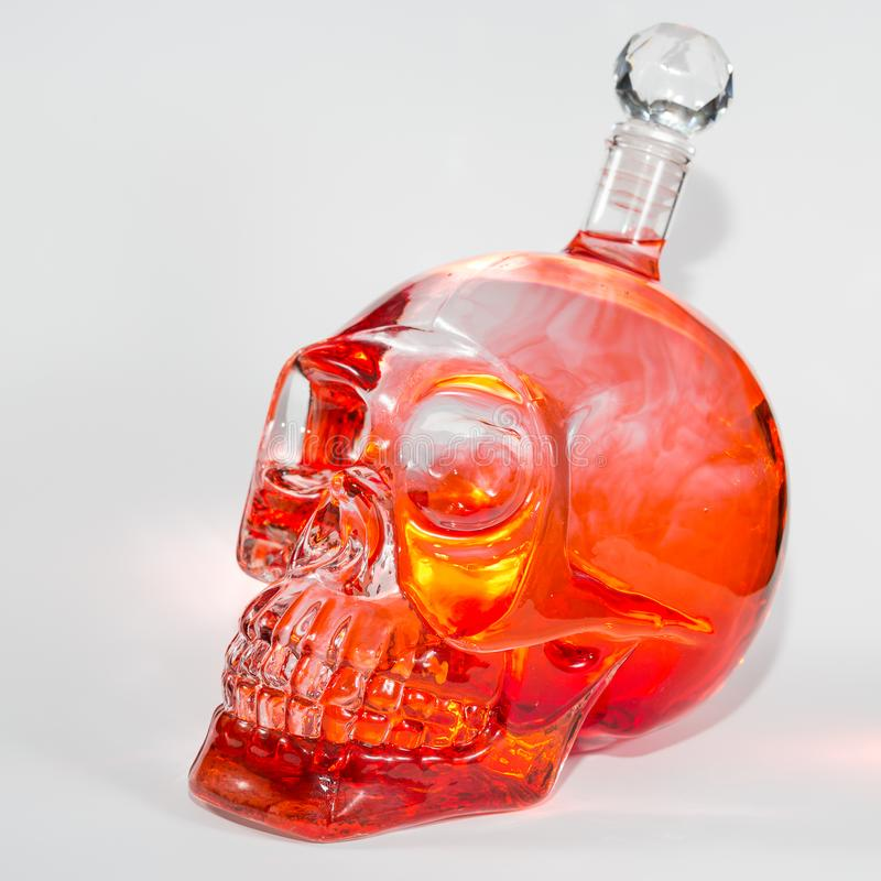 Glass skull with ink drops royalty free stock images