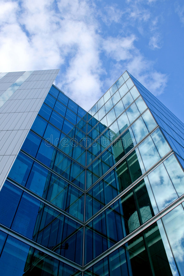 Glass skyscraper. Glass facade of business skyscraper with reflections stock image