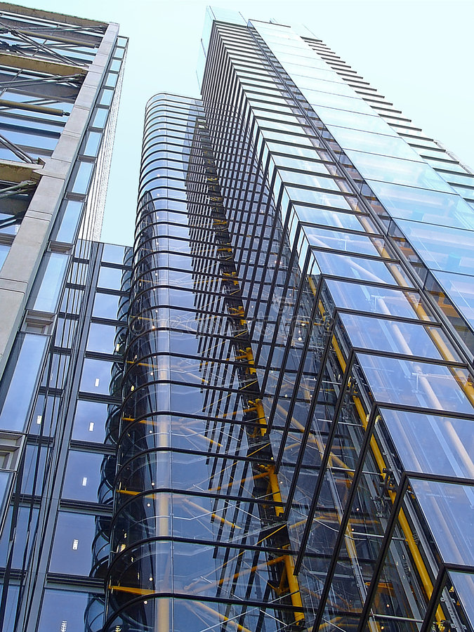 Glass skyscraper. Geometrical glass skyscraper with vanishing point perspective stock photos