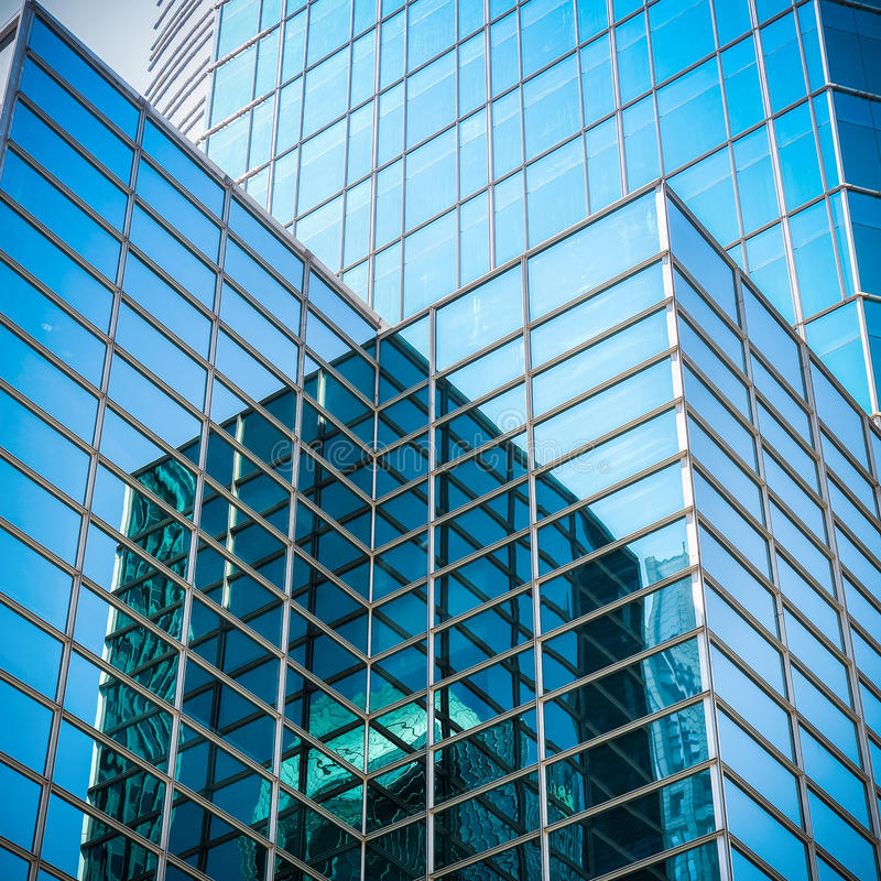 Glass skyscraper with abstract texture. Upward view of modern glass skyscraper,exterior of glass wall with abstract texture royalty free stock photo