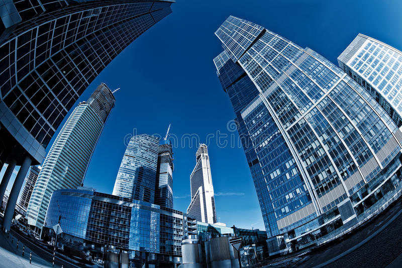 Glass skyscraper in the Moscow City. Shot fisheye lens royalty free stock images