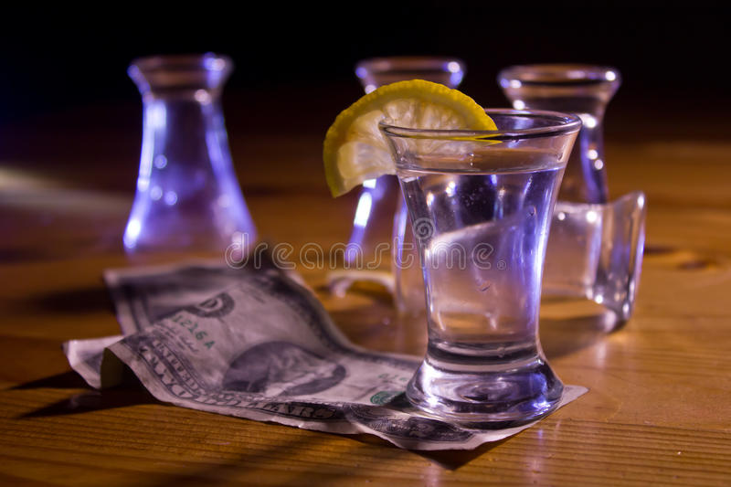 Glass with a slice of lemon royalty free stock photo