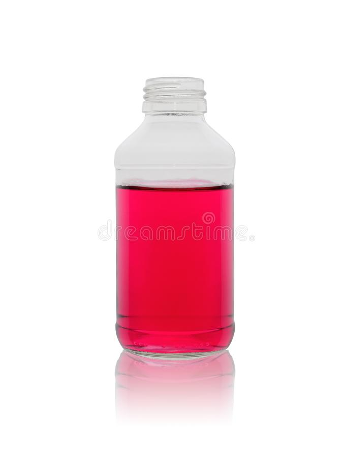 Glass small bottle with medication of a pink tsvetan on a white background with reflection royalty free stock image