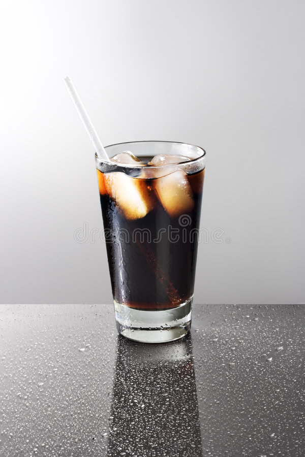 Glass of soda. On a wet, reflective table royalty free stock photography