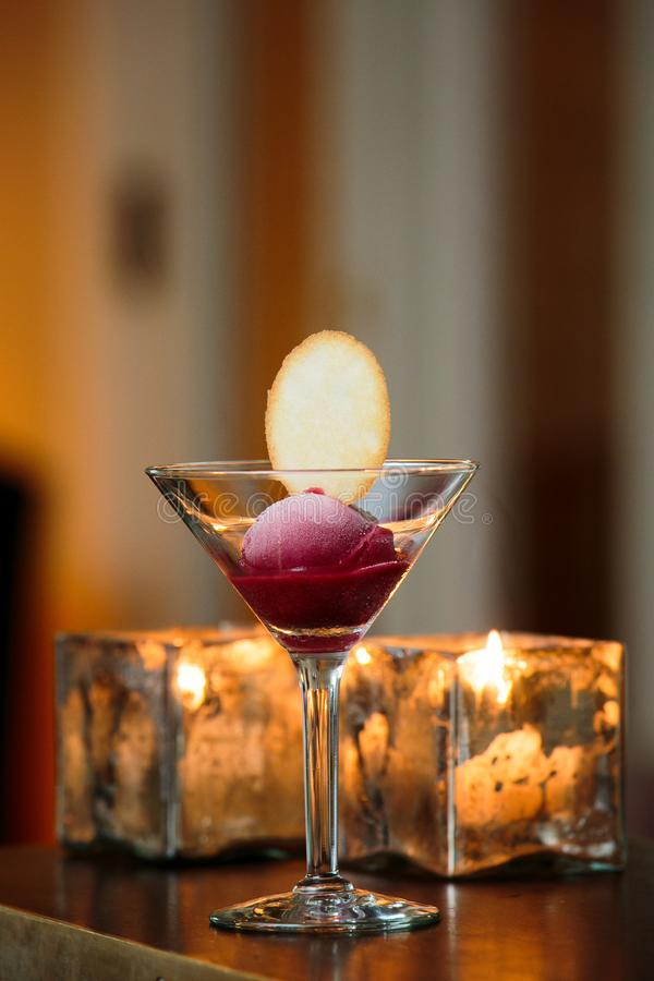 A glass with sorbet and a cookie served during a fancy wedding royalty free stock photo