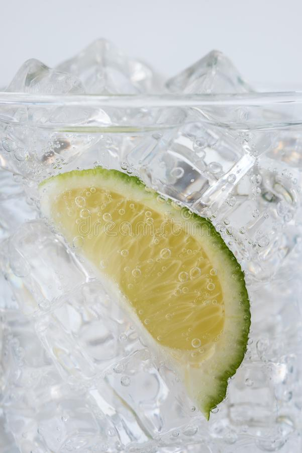 A lime wedge in tonic water royalty free stock photo