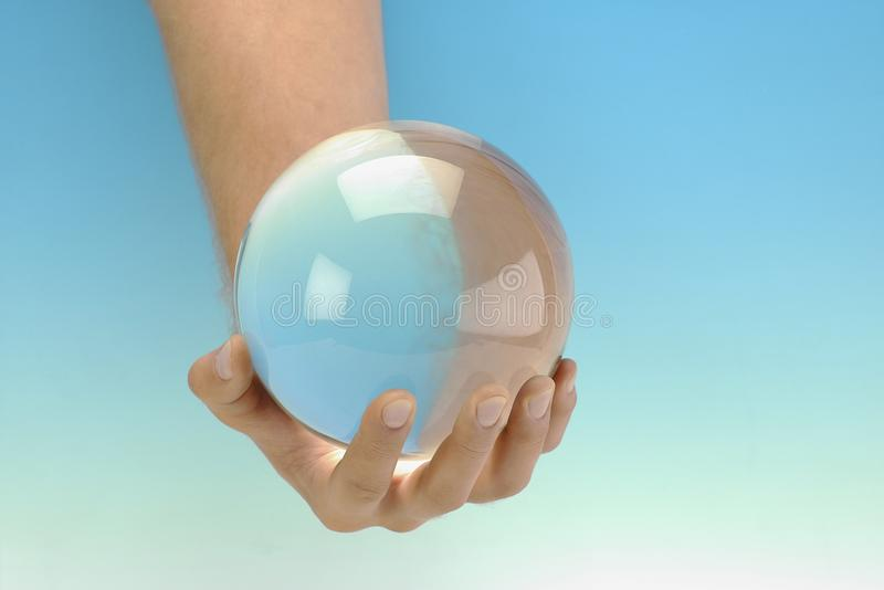 Glass sphere in a man's hand royalty free stock photos