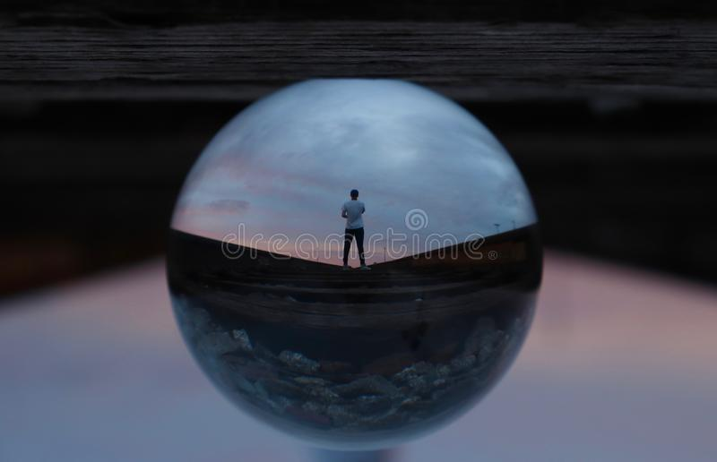 Glass sphere with man's reflection