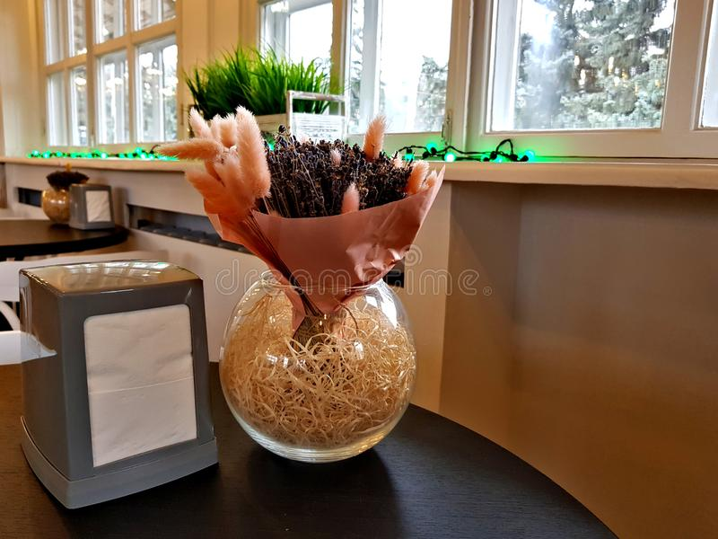 Glass vase with dry plants royalty free stock photos