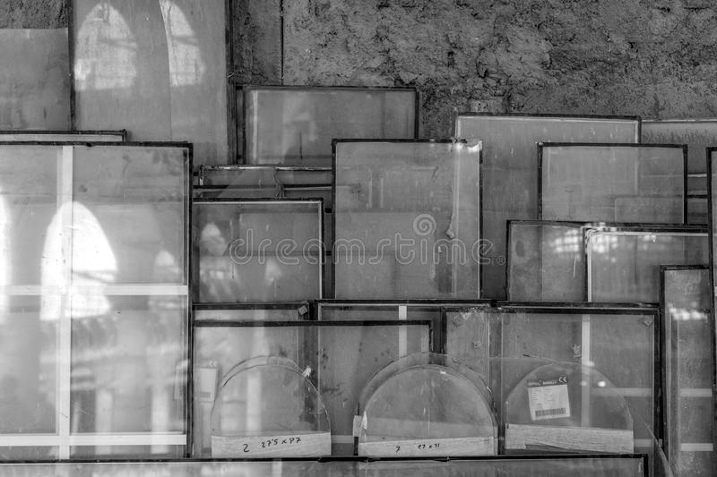 Glass stacked by a wall. Panes of glass stacked next to a wall in Justo Cathedral - Spain stock photo