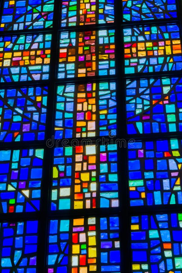 Glass Stained cross in a church royalty free stock photography