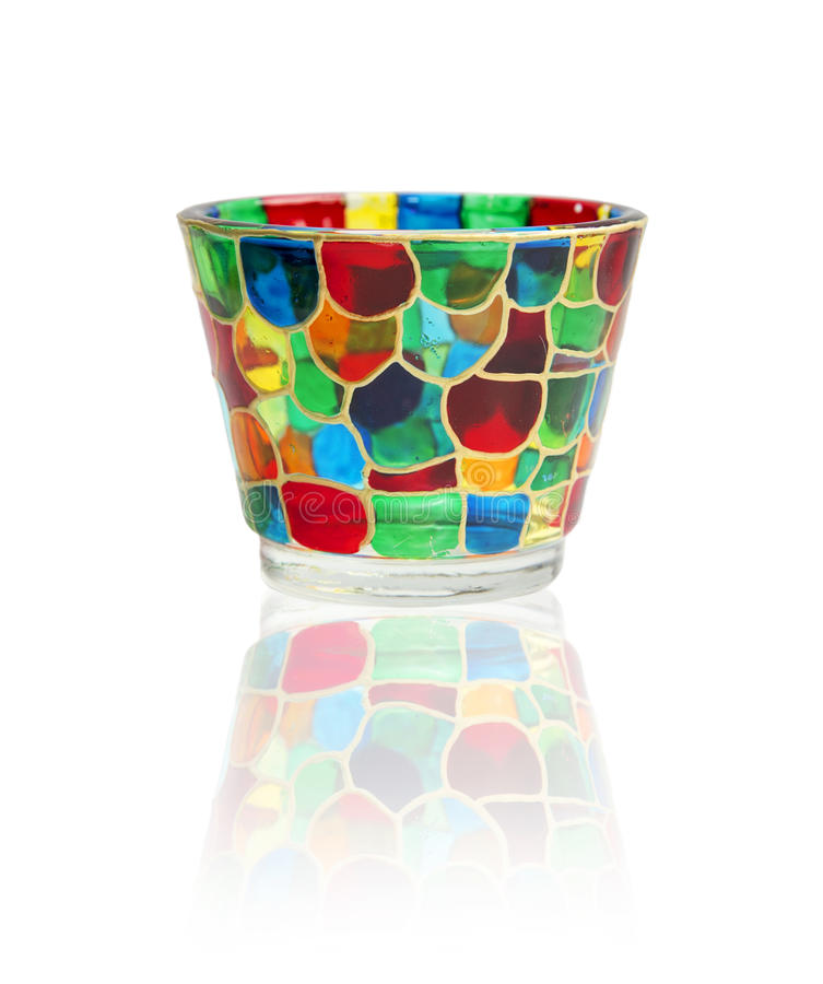 Glass with stained glass. Isolated on white background royalty free stock image