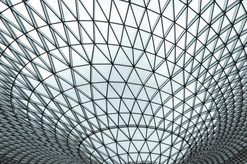 Glass and steel building with triangle pattern structure. Futuristic architecture. Neo-futurism architectural style. White. Triangle geometric dome texture stock photography