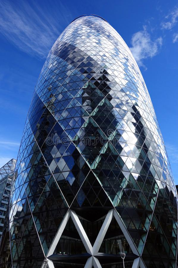 Glass and Steel Gherkin Skyscraper in London. The egg-shaped modern Gherkin Skyscraper towers above the streets of London, England royalty free stock images