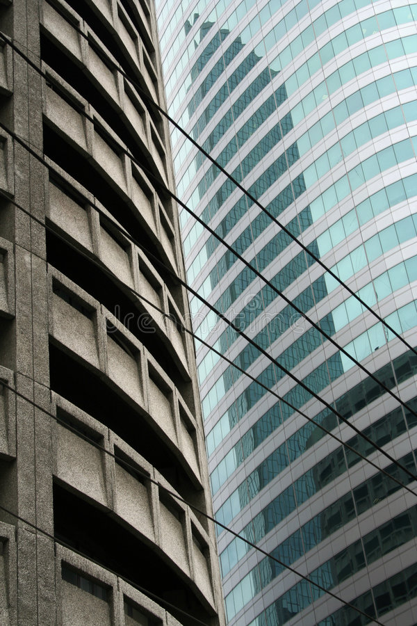 Glass and steel manila high rise architec. Contrasting old and new styles of high rise office and apartment architecture in manila the philippines royalty free stock photos