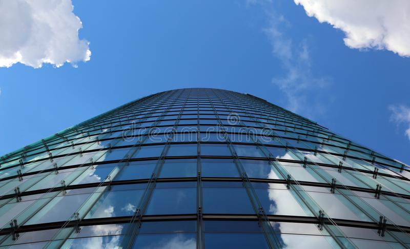 glass and steel skyscraper with sky background photographed with royalty free stock photography