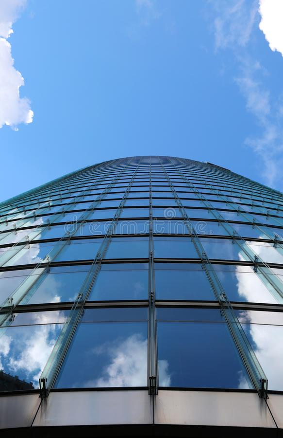 glass and steel skyscraper with sky background photographed with stock photo