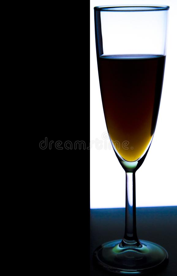 Glass or stemware with alcohol wine,whiskey,gin,beer,rum,vodka,Scotch,cognac,liquor,brandy,absinthe or cocktail on a black white stock photography