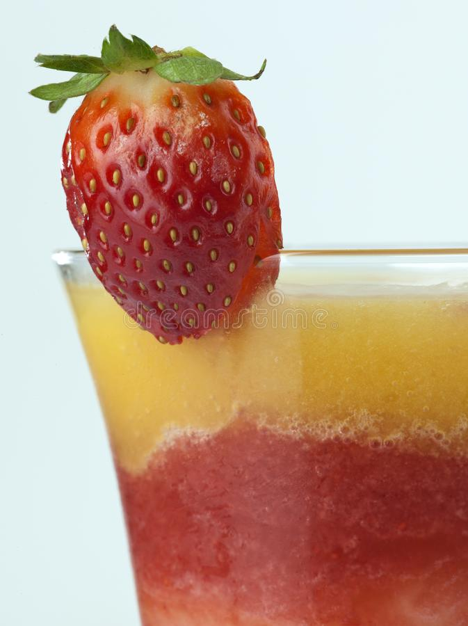 A glass of strawberry mango cocktail close up royalty free stock images