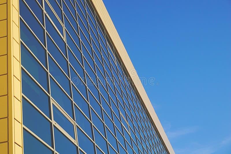 Glass surface facade with windows in a modern building stock photos