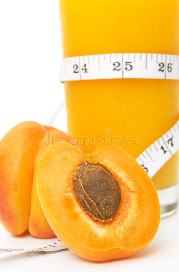 Glass of tasty juice with measuring tape stock photos