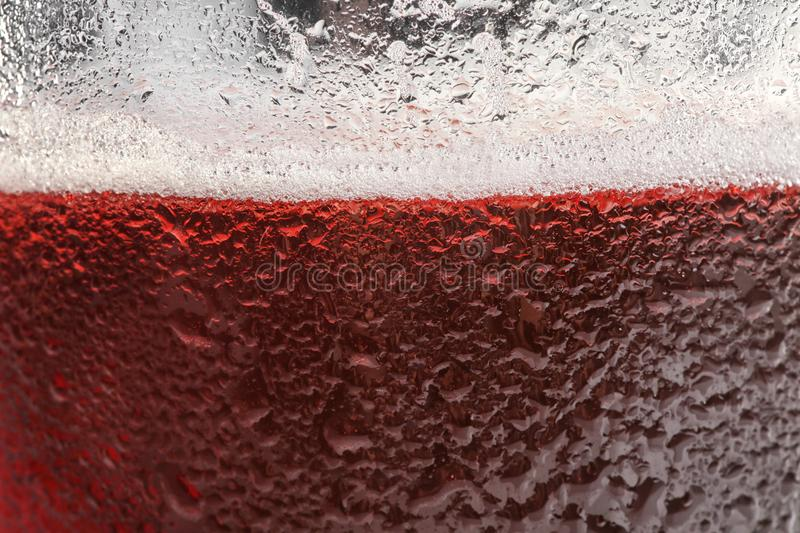 Glass of tasty red beer with foam closeup royalty free stock image