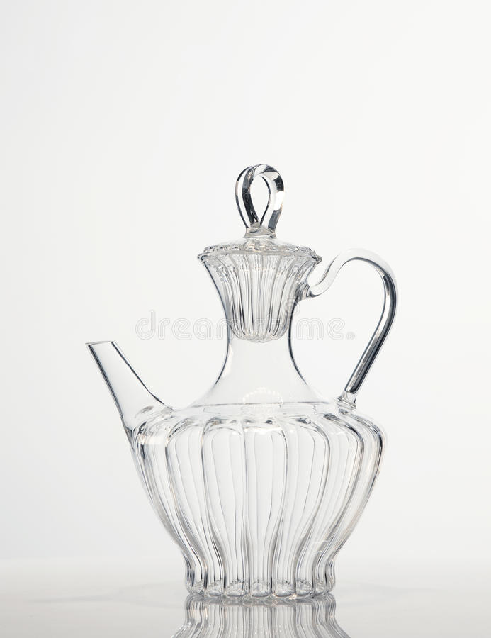 Glass tea carafe. A crystal classic wine carafe royalty free stock image