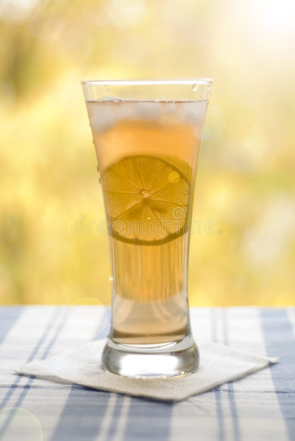 Glass with tea and lemon royalty free stock photography