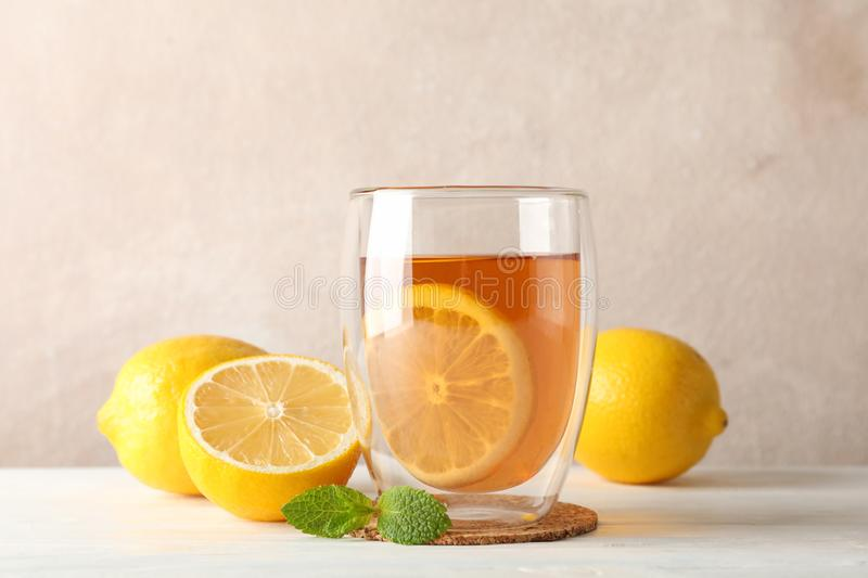 Glass of tea with lemon, mint, honey, dipper and ginger on wooden background royalty free stock photos