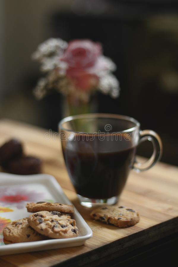Glass Teacup Beside a Cookies on Tray Placed on Table royalty free stock photos