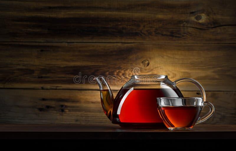 Glass teapot with black tea royalty free stock photo