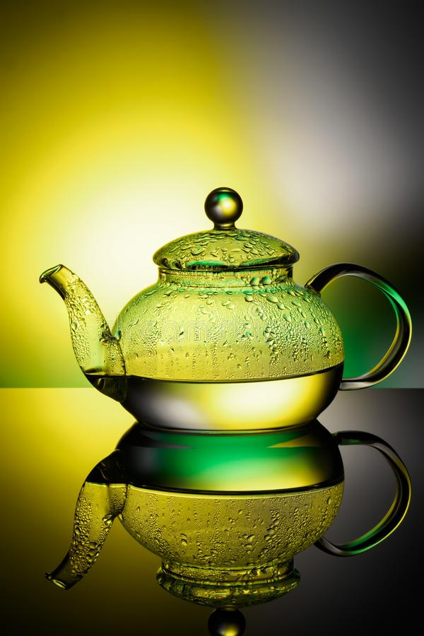 Glass teapot with boiling water and drops of condensation stock images