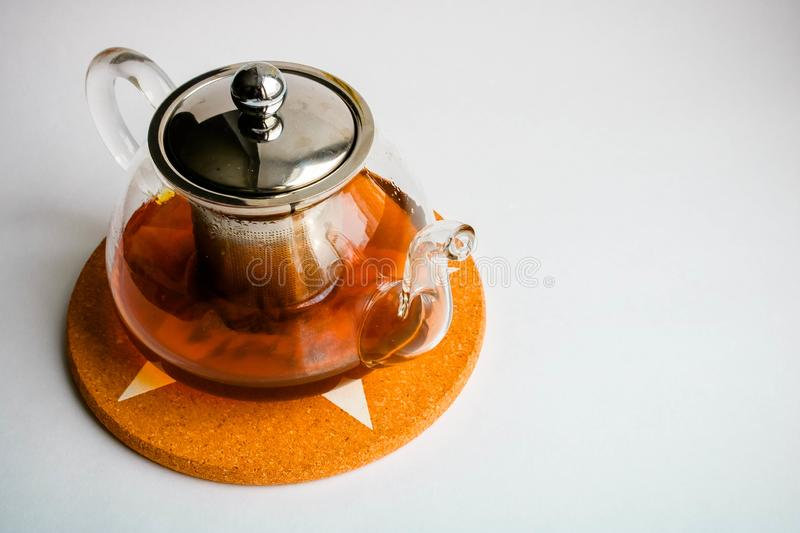 Glass teapot on white background. View from above stock image