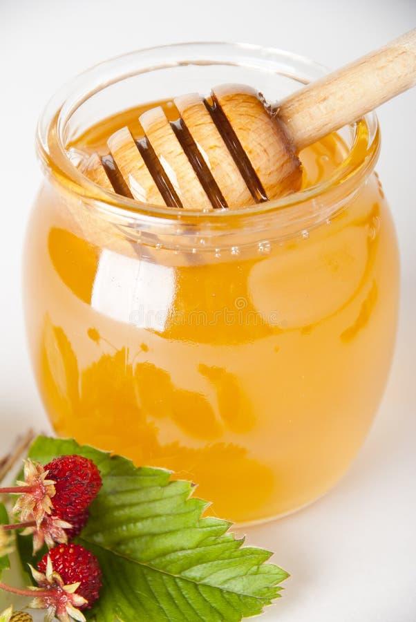 glass trähonungjar för drizzler arkivfoton