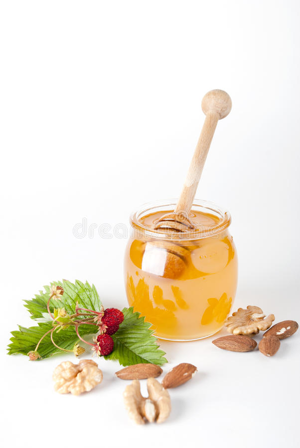 glass trähonungjar för drizzler royaltyfri foto