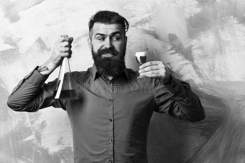 Glass tube or flask on colorful texture background. Brutal hipster holding alcoholic shot and glass tube or flask stock photo