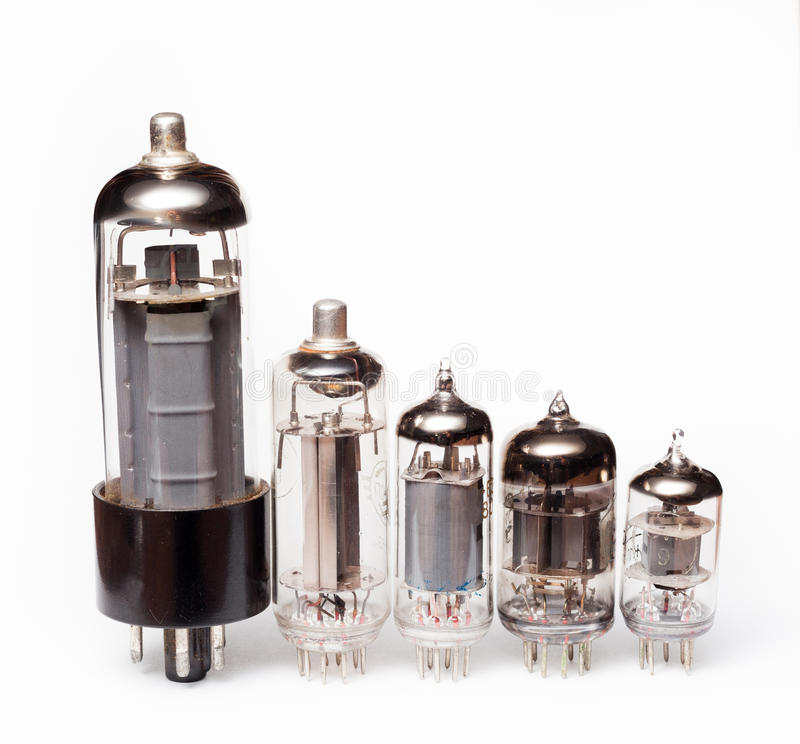 Glass vacuum radio tubes. Isolated image on white background. Evolution of glass vacuum radio tubes. Different generations of components. Isolated image on white royalty free stock photos
