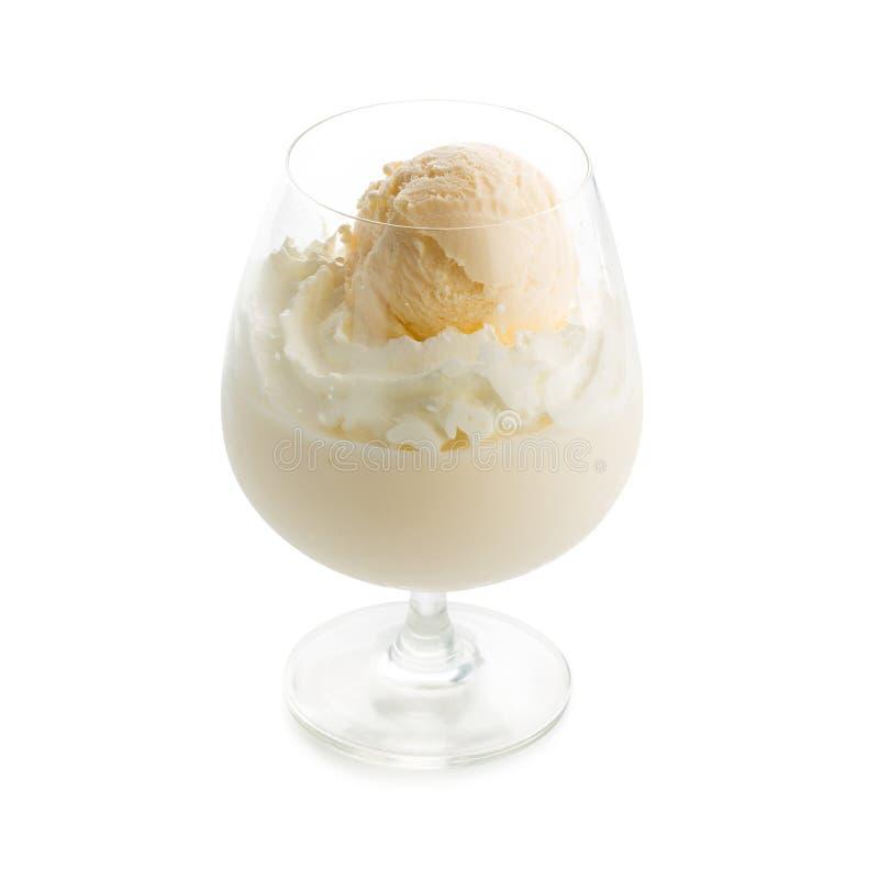 Glass of vanilla milkshake with vanilla ice cream topping isolated on white background royalty free stock photo