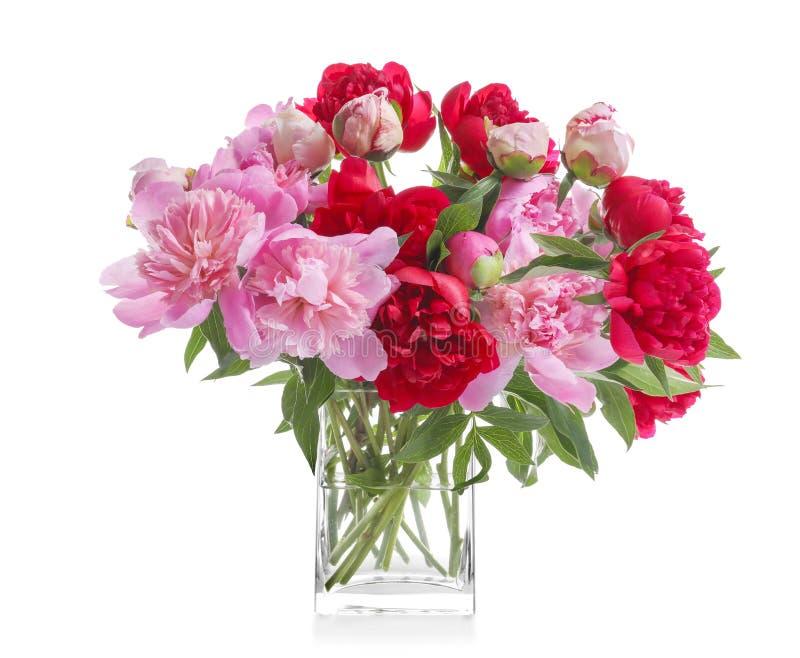 Glass vase with beautiful peonies stock photos